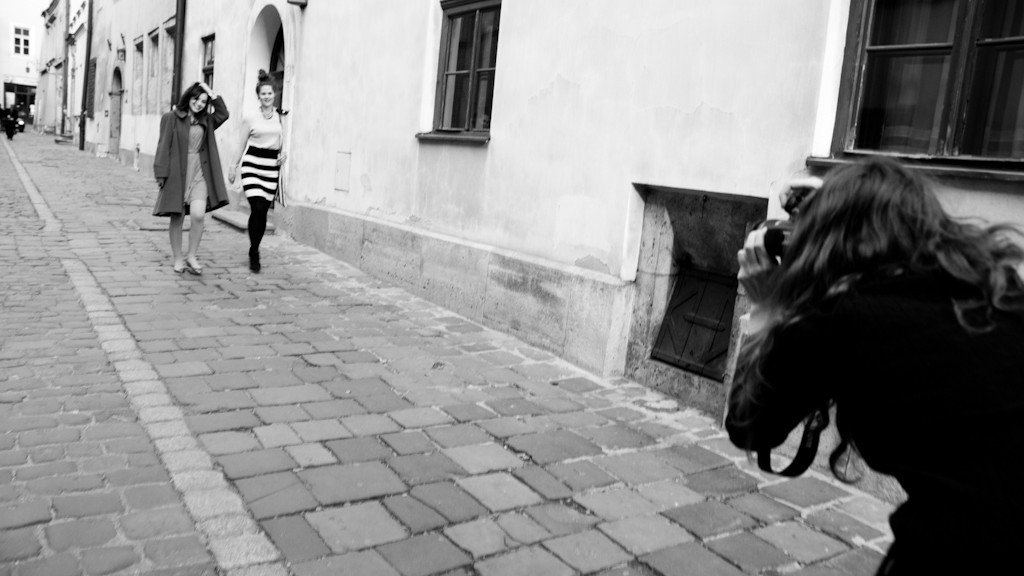 Photographer with models in action on Kanonicza street in Krakow