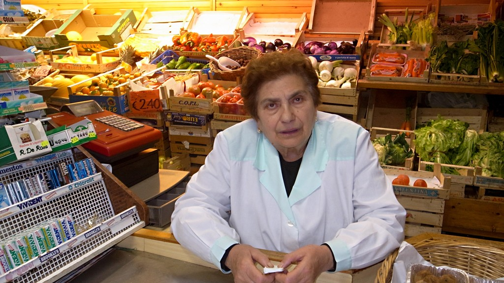 CONCETTA IN HER FRUITS AND VEGETABLE SHOP