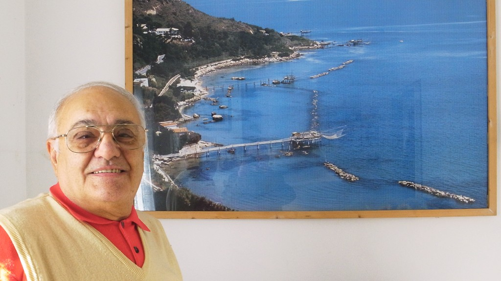 Dr. Trozzi with a picture of trabocchi at lunch today